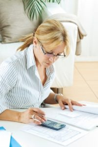 accountants for physiotherapists - woman with calculator